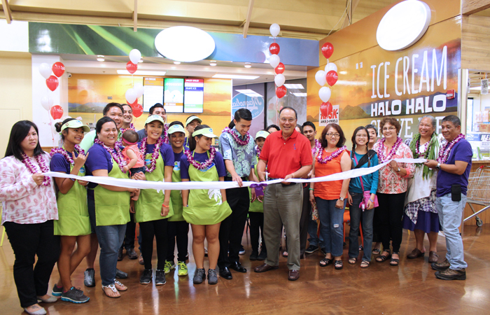 Ramar Foods President Primo Quesada with his family and friends celebrating the grand opening of the very first Magnolia scoop shop.