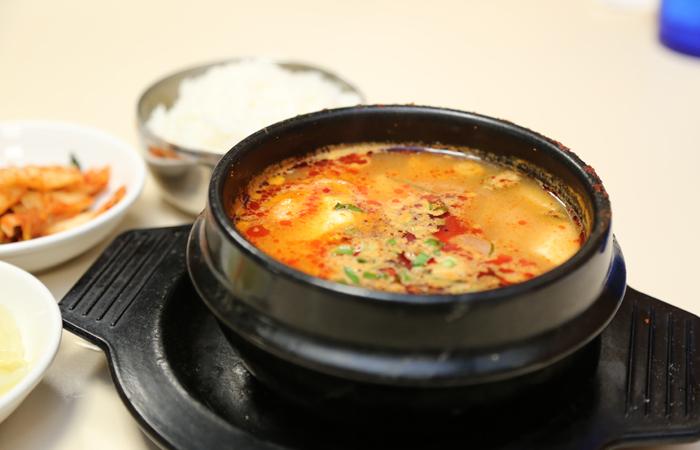 The still-boiling seafood soup ($13.95) is briny with shrimp, squid and butterfish.