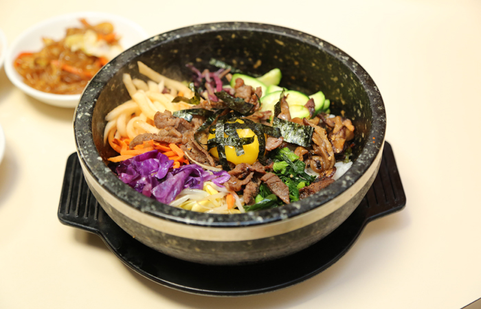 My number one dish at Korean restaurants is dol sot bi bim bap. The dish ($14.95) is served in a steaming stone pot that delightfully crisps the rice as you mix it with a flavorful kochujang. I love that it's full of flavor, crunch, heat and refreshing crisp veggies.
