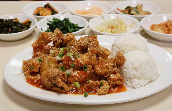 The spicy garlic chicken ($12.95) jumps out at me. The crispy pieces are battered, deep fried and tossed in a sweet chili sauce loaded with garlic. The sticky sauce is familiar and delicious.