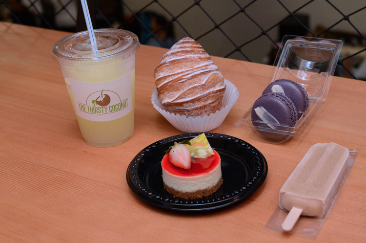 Coconut lemonade slush, vanilla bean custard-filled cruffin, sweet potato macarons, chai tea pop and cheesecake.
