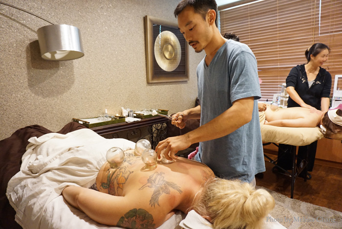 A cupping student at Laka Spa checking the suction and sliding it.