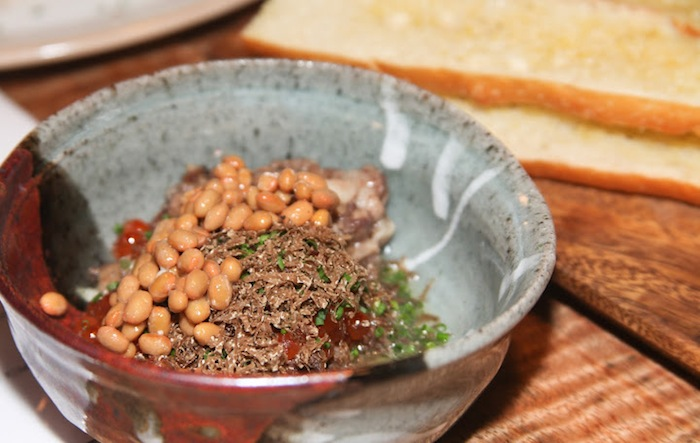 Bone marrow, black truffle, ikura and natto, spooned onto buttered baguettes