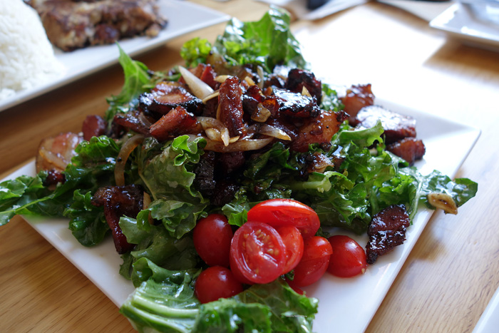My favorite at Holoholo Bar & Grill: Smoke meat on wilted kale salad.