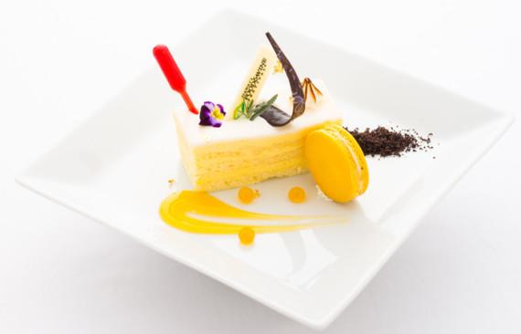 Chef Jayson Kanekoa's lilikoi sponge cake with goat cheese panna cotta and passion fruit macaron.