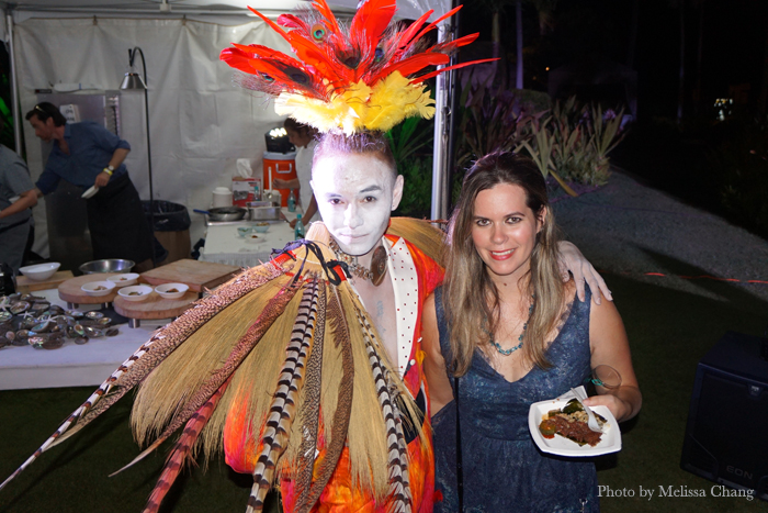 Perfomer's from Maui's Ulalena show wandered throughout the event to entertain guests. This one is shown here with Hawaii magazine editor Christine Hitt.