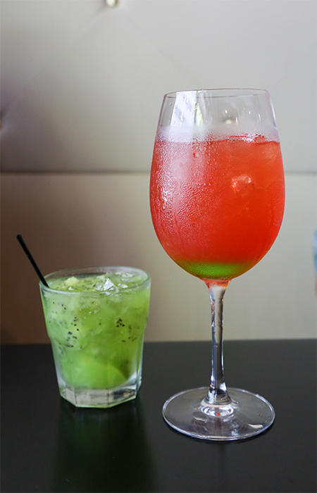 The kiwi capriosca ($8, left) is a refreshing cocktail of fresh kiwi, lime, simply syrup, vodka and midori. The jolly bear ($8, right) is a sweet cocktail of Absolut berry acai, Kai lychee, midori, peach schnapps, pineapple, cranberry, lime and club soda.