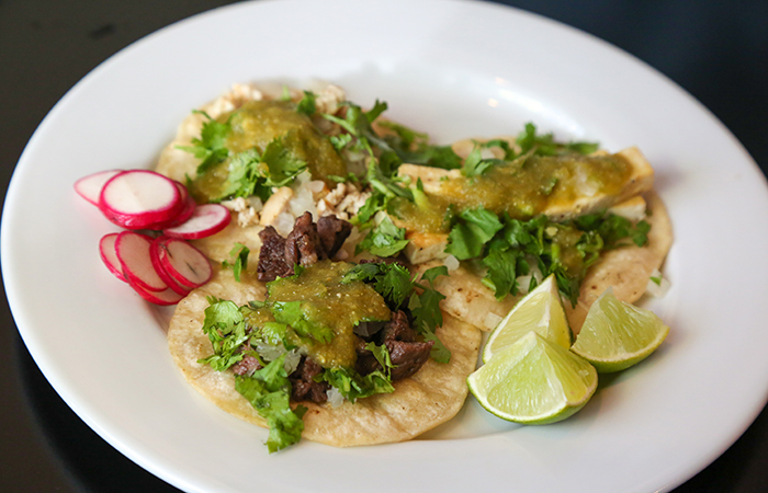 The Dumb Coq debuted at First Friday with free tacos. The tacos ($7 for an order of 3) are now an appetizer on the menu and include a mouthwatering salsa verde with a nice zing.