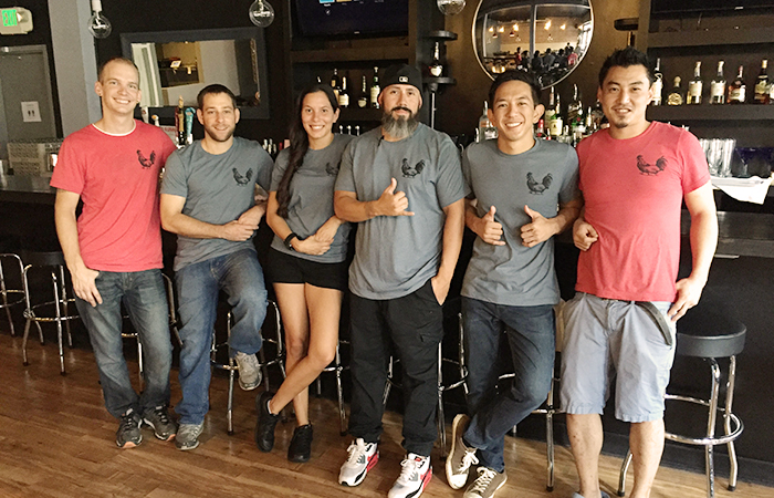 The Dumb Coq team. Owner Yoon Kim, far right.