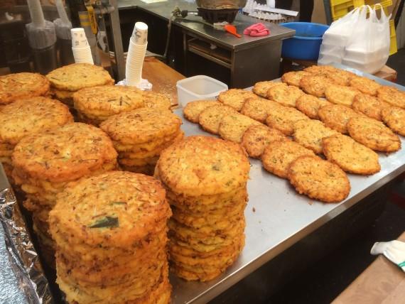 Large stacks of bindaedduk. I wish I could eat them all.