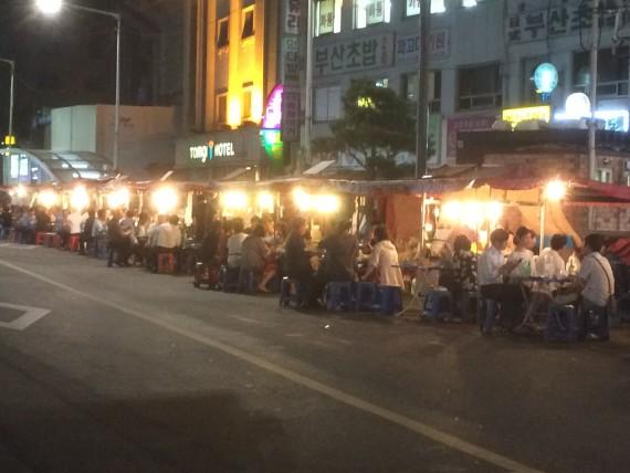 Pojangmacha line the street at night