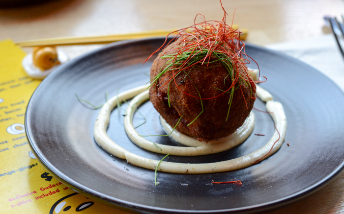 The starter was a play on the scotch egg, a soft-boiled soy egg wrapped in spicy pork belly sausage and deep fried to a crisp. It was served on a spicy aioli, which brought the flavors together nicely. The various textures, from oozing yolk to crunchy exterior, made it a standout dish.