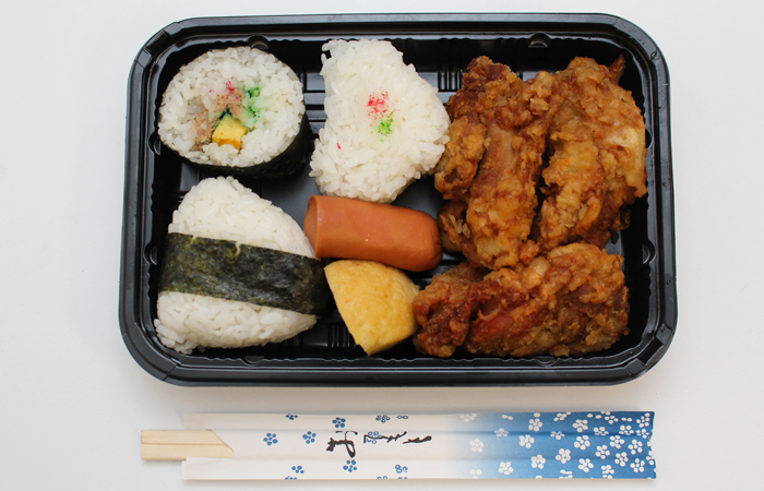 K's Bento-ya is known for opening early (5 a.m.) and closing when they run out (usually before noon). They only make a set number of bentos a day, cash only.