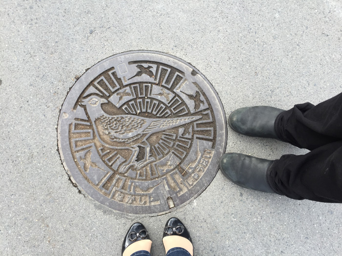 Every city in Japan has its own manhole cover design. Here's what we saw on our way to the brewery.