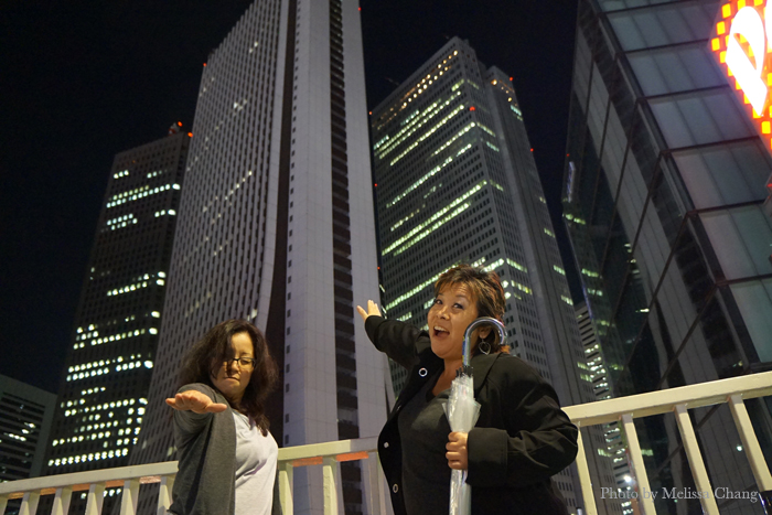 Me and Deb on a popular pedestrian overpass in Shinjuku, where many superhero photos are taken. Photo by Matt Alt.