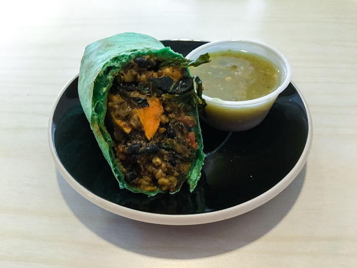 The breakfast burrito ($7.50) changes often, but consistently includes a healthy dose of legumes, sweet potatoes, kale, peppers and side of organic salsa verde. This is one cut in half.