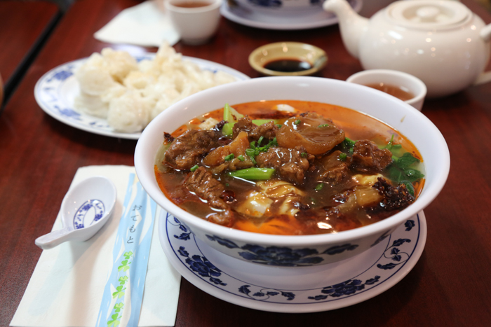 Beef and tendon look fun soup with a generous helping of sambal.