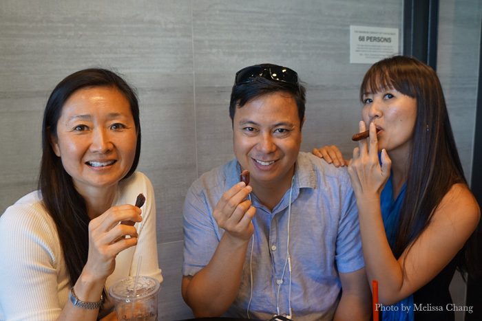 My panel of taste testers, from left: Diane Seo, Kaimana Pine, and Edwina Minglana (who does not know how to smoke a cigar in real life).