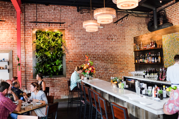 Hints of the restaurant's Brooklyn-meets-Hawaii roots can be found in the original exposed brick, rich hardwoods and custom lighting fixtures.