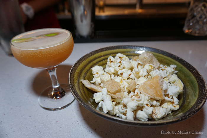 Duck fat popcorn ($6) and a cocktail called The Earth + Sea ($10).
