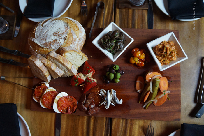 Antipasto plate ($16) with extras like marinated mushrooms ($7) smoked ahi stuffed piquillo peppers ($12).