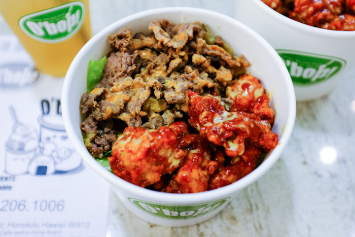 Filled to the brim with delicious KFC and beef bulgogi. You'll find rice and salad below this layer of meat, I promise.