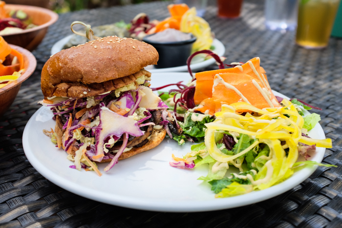 If you're looking for a burger replacement, the BBQ portobello sandwich is your best bet. It has a local organic portobello mushroom topped with coconut slaw on a locally baked vegan bun.