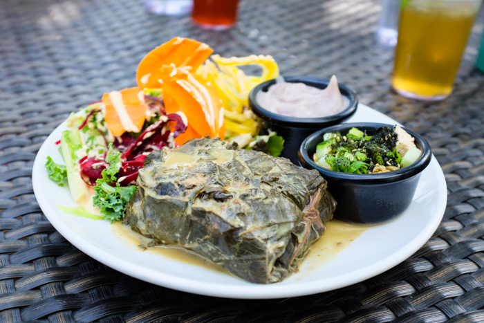 The WOW Laulau has slow-cooked local veggies in luau leaves with a choice of poi, brown rice, or millet with tofu poke (plain or spicy) and fresh greens.