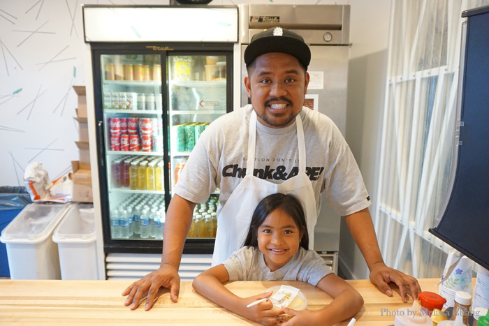 Sheldon with daughter Peyton at the counter.