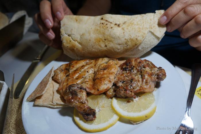 Grilled chicken half, 42 AED.