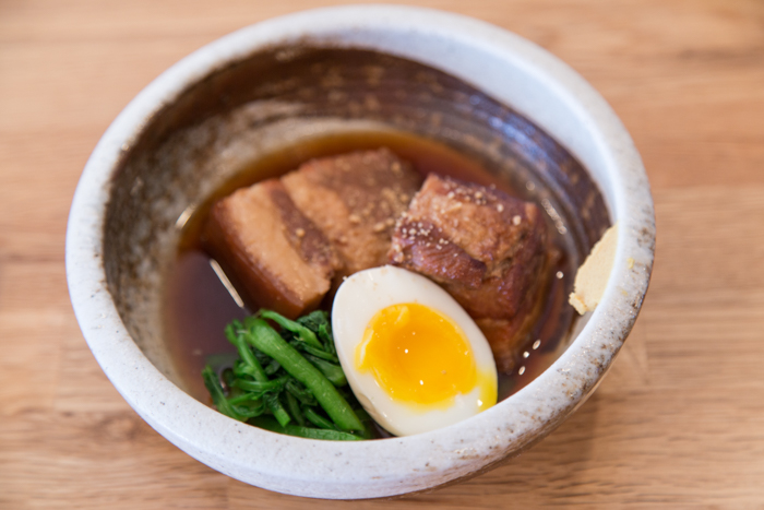 The pork belly kakuni ($9) is a must-order with marinated, succulent layers of meat and fat with a beautifully soft-boiled egg and greens.