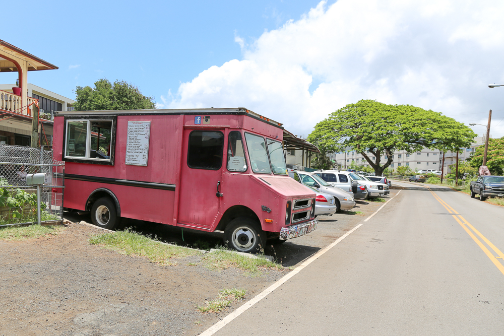 Drive down Kohou St. right after the entrance to Damien and look for a bright pink food truck parked in the driveway of a home.