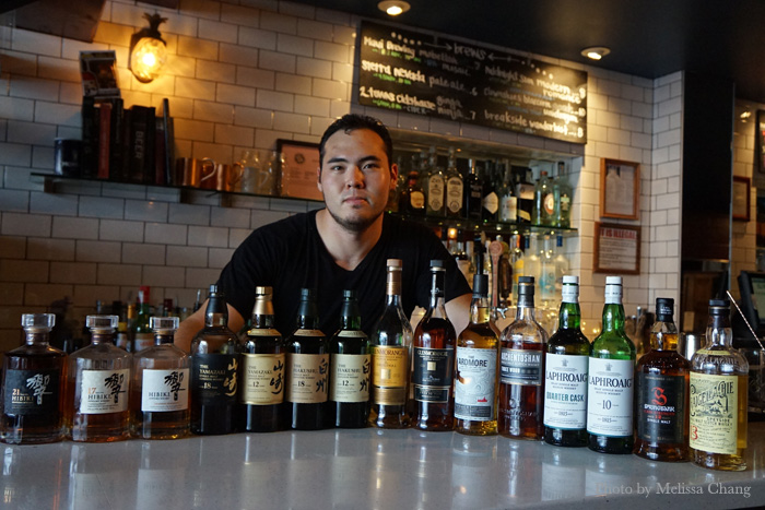 Bar manager Joe Arakawa with the whiskies for June 8.