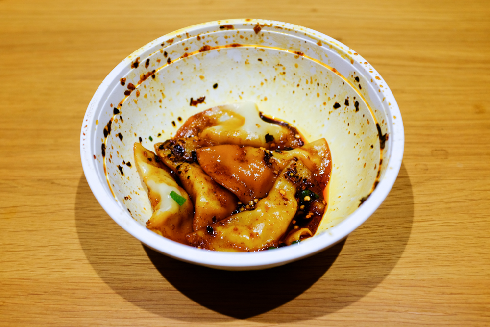 We eat with our eyes first, but don't let this impression turn you away. The spicy oil dumplings (5 for $5 NZD / $3.50 USD) Eden Noodles are SUPER GOOD.