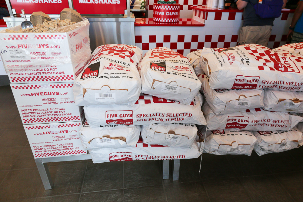 50 pound bags of potatoes that Five Guys sources from farms and cuts fresh for fries each day.