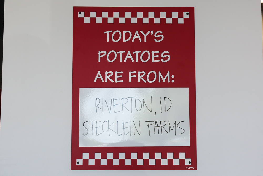 Each Five Guys location proudly displays the region and farm that grew the potatoes for the fries they are cooking up that day.