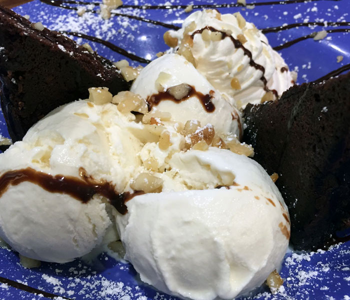 There's something irresistible about those warm, fudgy brownies topped with a luscious mountain of Bubbies vanilla bean ice cream, hot fudge, mac nuts and whipped cream.