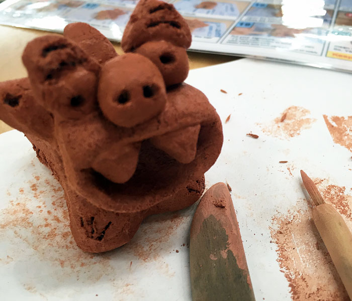DIY shisa sculpting. It's a lot harder than it seems.