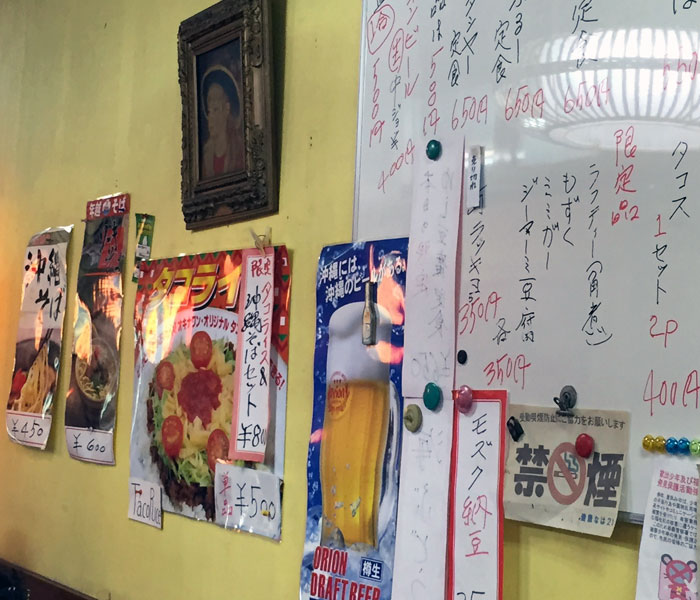 I'm sure the eatery offered more than just taco rice and soba, but those are the only photos we can make out. By default, everyone orders either entrée and my brother gets an Orion (Okinawan) beer.