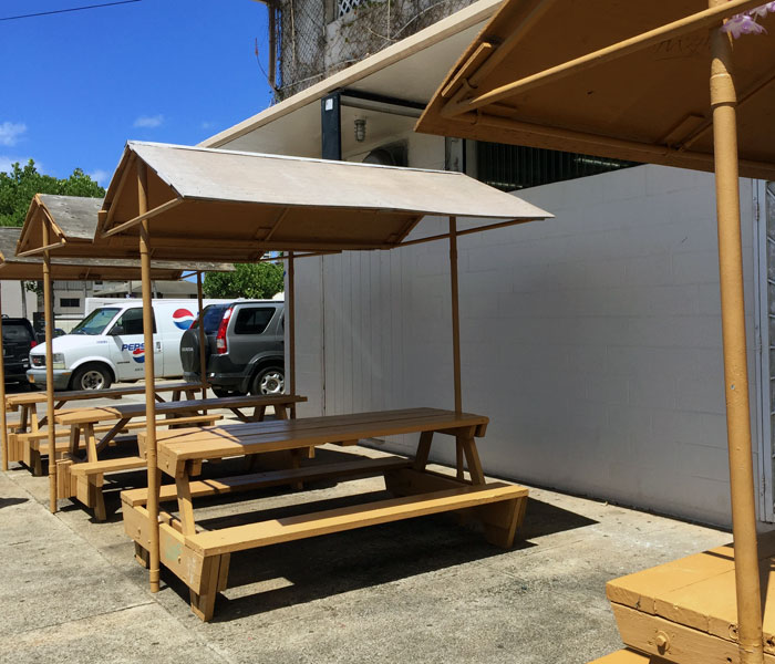 Several picnic tables are located outside of the eatery.