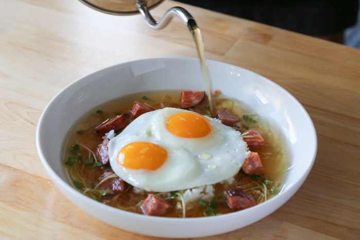 One of the dishes Nik is most proud of is the Kailua eggs ($12). When testing out dishes for the Over Easy menu, he substituted kombu and bonito with bacon and cabbage to create a riff on a classic dashi. To this broth he adds sriracha and sherry vinegar for a light, flavorful broth that is poured over Portuguese sausage, eggs and rice.