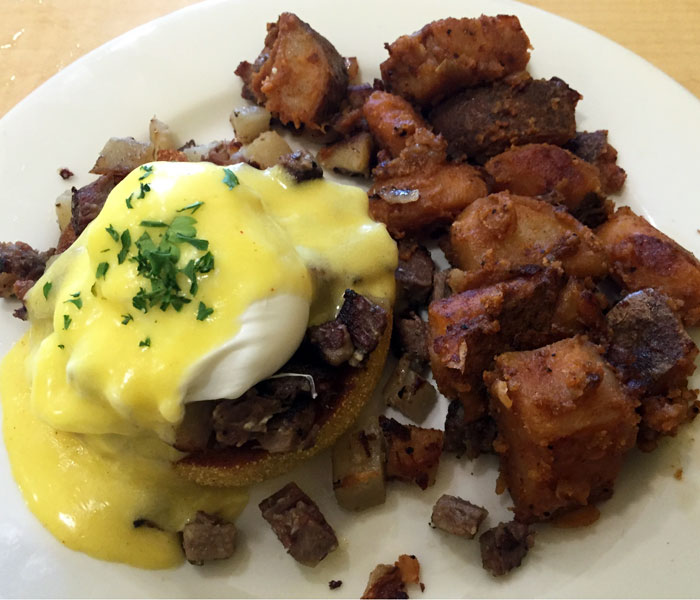 All bennies are served on a toasted English muffin topped with a poached egg and homemade Hollandaise sauce and come with breakfast potatoes. Half orders get one muffin and less potatoes.