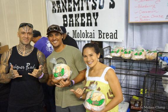 We caught Na Hoku Hanohano Award-winner Blayne Asing (center) helping his family at the Kanemitsu Bakery booth.