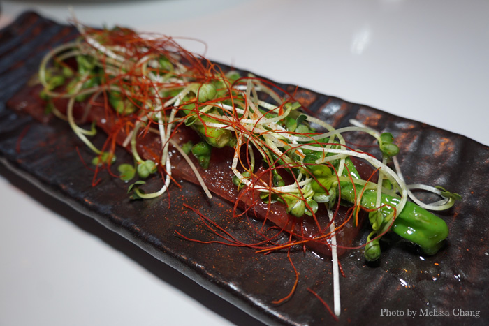 Blistered shishito peppers ($14) are still a menu fad, but Stripsteak's take has them on a bed of watermelon carpaccio, sprinkled with esplette pepper and daikon sprouts. The peppers by themselves aren't different, but I loved the savory and spicy flavors all over the pressed watermelon.