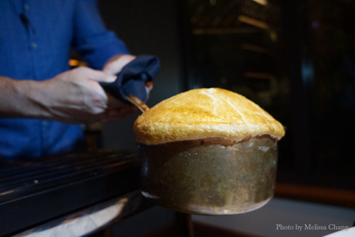 Michael Mina restaurants all serve the same signature dish: His lobster pot pie, which is $105. The top crust is removed tableside as your server explains the ingredients.