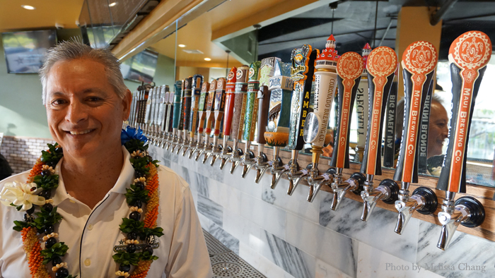 Bill Muneno with some of his beers on tap.