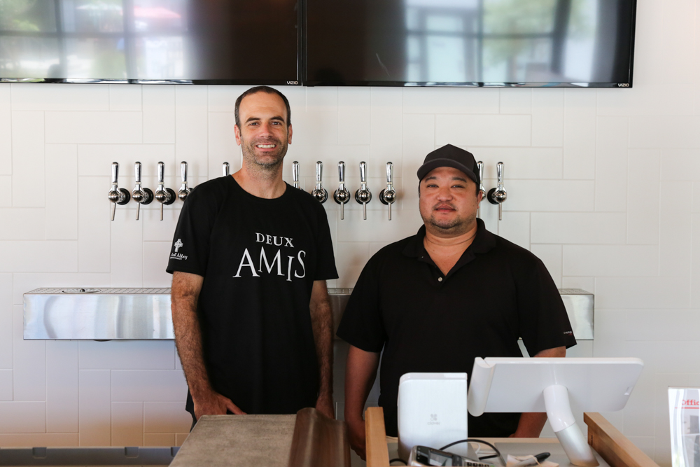 Beer aficionados and owners, Tim Golden and Daryn Ogino.