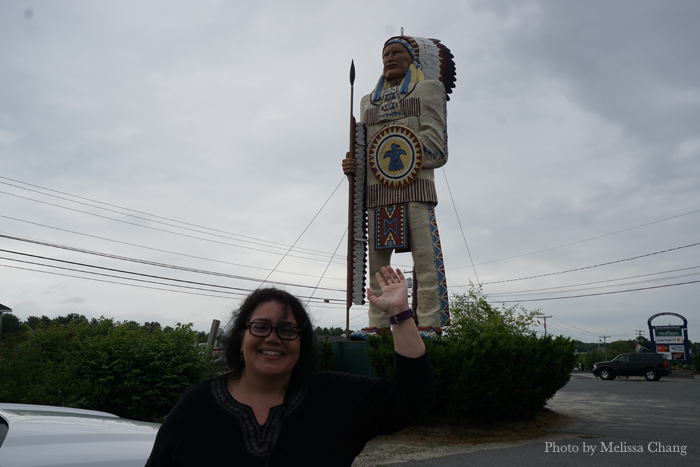 "Playing tourist: Jodie, who calls herself ""Ghandi Indian,"" with a giant American Indian statue."