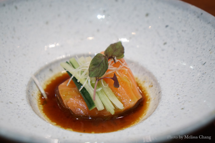 Ora king salmon with spicy sesame ponzu, yuzu kosho, and scallion oil.