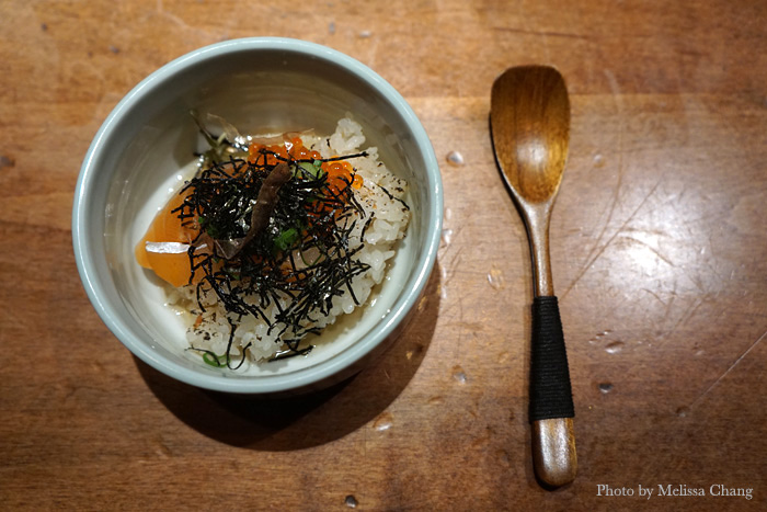 Smoked arctic char donabe with furikake, katsobushi, green onion, rainbow trout roe, and quail egg.